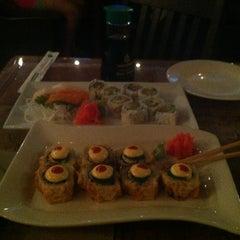 Photo taken at Manu's Tapas Bar & Sushi Lounge by Alex P. on 6/25/2013