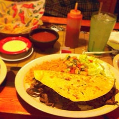 Photo taken at Cancun Mexican Restaurant by Tara R. on 3/19/2014