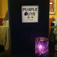 Photo taken at Purple Olive International Bistro by Juniper E. on 12/18/2014