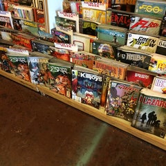 Photo taken at Ash Avenue Comics and Books by Mimmo on 6/19/2014