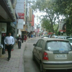 Photo taken at Defence Colony Market by Neha G. on 12/12/2012