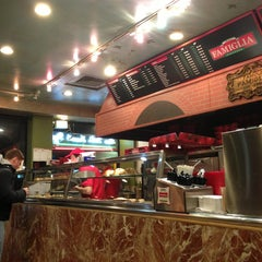 Photo taken at Famous Famiglia Pizza by Lane R. on 12/24/2012