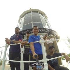 Photo taken at Muka Head Lighthouse by Syafiq I. on 4/19/2015