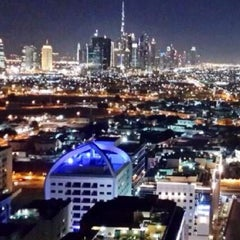 Photo taken at Majestic Hotel Dubai Rooftop Pool by Brian B. on 12/27/2013