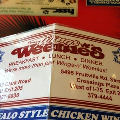 Photo taken at Wings and Weenies by Joseph B. on 3/21/2013