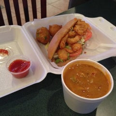 Photo taken at Louisiana Seafood Kitchen & Market by Ivy C. on 10/2/2012