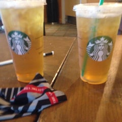 Photo taken at Starbucks by isaac g. on 6/10/2014