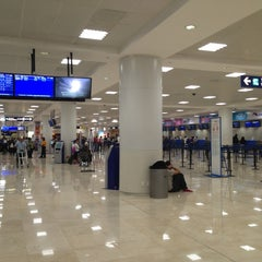 Photo taken at Aeropuerto Internacional De Cancún (CUN) by Jesus R. on 3/14/2013