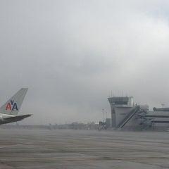 Photo taken at Gate 31 by Dragon L. on 1/15/2014