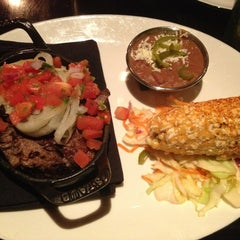Photo taken at Dos Caminos by Emily on 12/28/2012