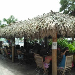 Photo taken at Bamboo Beach Tiki Bar & Cafe by Michael O. on 7/20/2013