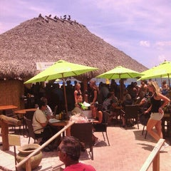 Photo taken at Bamboo Beach Tiki Bar & Cafe by Michael O. on 6/20/2013
