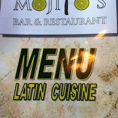 Photo taken at Mojitos Cuban Bar & Restaurant by Julianna H. on 7/20/2013