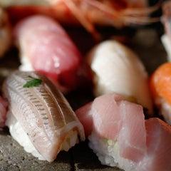 Photo taken at Sushi Taro by Food Network on 3/20/2013