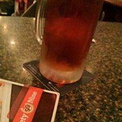 Photo taken at Ninety Nine Restaurant by Mark O. on 12/29/2014