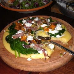 Photo taken at Andre's Cucina & Polenta Bar by Peter P. on 3/22/2013