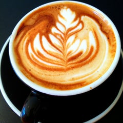 Photo taken at Contraband Coffeebar by Christina M. on 5/23/2013