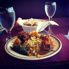 Photo taken at Saffron Indian Cuisine by Gloria K. on 5/5/2012