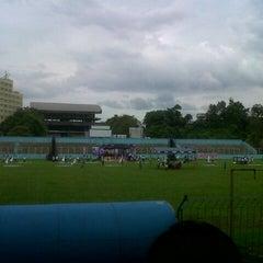Photo taken at Stadion Klabat by Talita L. on 7/28/2013