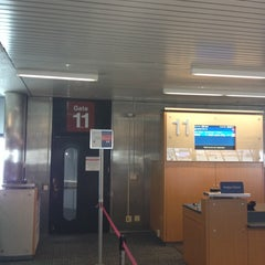 Photo taken at Gate 11 by Greg A. on 3/22/2014