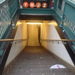 Photo taken at MTA Subway - Delancey St/Essex St (F/J/M/Z) by Andrew A. on 6/27/2013