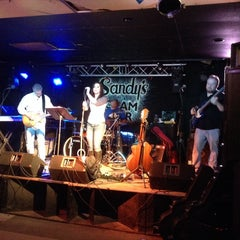 Photo taken at Sandy's Clam Bar by Stephanie R. on 2/7/2014