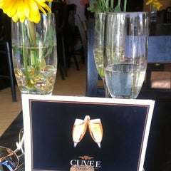 Photo taken at Cuvee Champaigne & Wine Bar by Leila P. on 7/1/2013