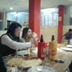 Photo taken at La Bella Pizzaria by Renato K. on 1/12/2013