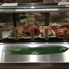 Photo taken at 魚がし日本一 新橋日比谷口店 by kenji o. on 3/13/2013