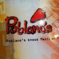 Photo taken at Poblano's Mexican Bar & Grill by Erin R. on 2/24/2013