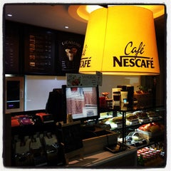 Photo taken at Café NESCAFÉ by YK J. on 9/15/2013