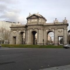 Photo taken at Puerta de Alcalá by Doris S. on 1/15/2013