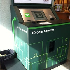 Photo taken at TD Canada Trust by Lily C. on 3/16/2013