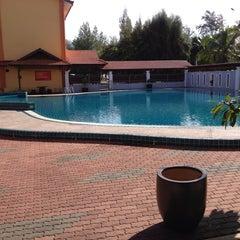 Photo taken at Demong Beach Resort by Nurul F. on 9/9/2014
