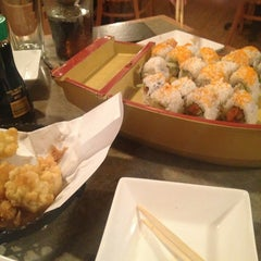Photo taken at Wasabi Sushi Bar by Paige D. on 5/17/2013