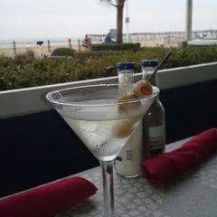 Photo taken at RockFish Boardwalk Bar & Seagrill by Jill E. on 5/9/2014