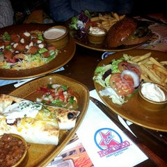 Photo taken at Foster's Hollywood by Laura L. on 3/27/2013
