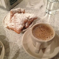 Photo taken at Café du Monde by Matthew S. on 4/28/2013