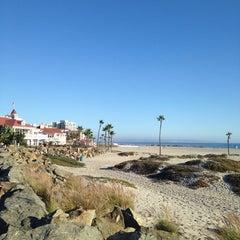 Photo taken at Coronado Beach by Aziz AlSaeed on 9/25/2013
