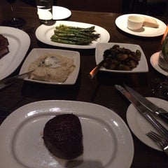 Photo taken at Carnevor Steakhouse Moderne by Mia T. on 3/18/2015