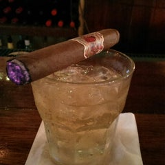 Photo taken at Dos Jefes Uptown Cigar Bar by Uday M. on 9/2/2013