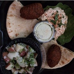 Photo taken at Papouli's Mediterranean Cafe and Market by Stacy on 4/6/2014