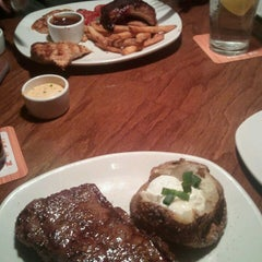 Photo taken at Outback Steakhouse by Nicole V. on 3/2/2013