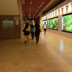 Photo taken at Tampines MRT Station (EW2/DT32) by Stephanie O. on 7/13/2013
