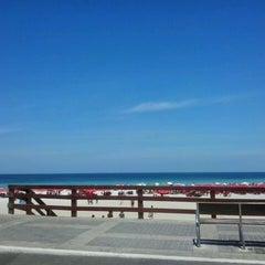 Photo taken at Praia Grande by Gabriela R. on 2/15/2013