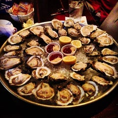 Photo taken at Coast Seafood & Raw Bar by Kyle L. on 4/18/2013