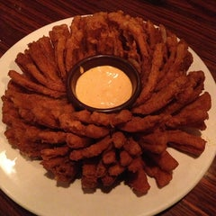 Photo taken at Outback Steakhouse by Thomas H. on 3/30/2013