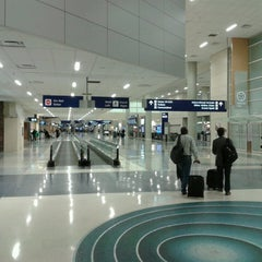 Photo taken at Terminal D by Gabriel F. on 3/12/2013