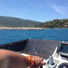 Photo taken at Marina Di Cala Galera by Ugo A. on 6/5/2014