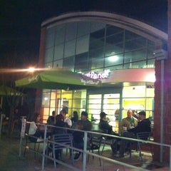 Photo taken at Yogurtland by Carlos C. on 1/3/2012